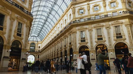 milan fashion : MILAN, ITALY - CIRCA MAY 2018: Shopping in the city. Shopping mall customers in Galleria Vittorio Emanuele, tourism, architecture