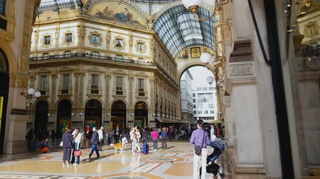 milan fashion : MILAN, ITALY - CIRCA MAY 2018: Shopping in the city. People walking in famous Galleria Vittorio Emanuele, Italian sightseeing, travel