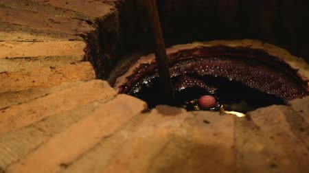 buried : Tourist tasting wine from qvevri buried underground, delicious exclusive drink