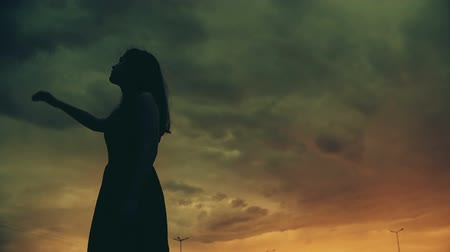 wicked : Young woman raising hand up to night scary sky, nightmare, horror mystery