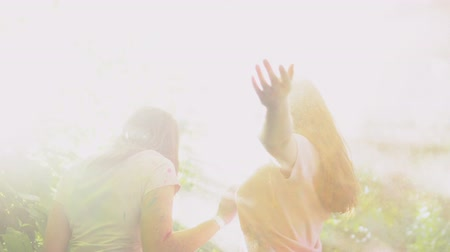lesbijki : Girls enjoying pleasure pastime together spraying colorful powder and kissing