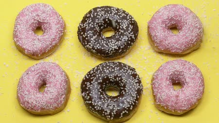 high calories : Closeup of donuts sprinkled with sugar, homemade dessert production. Stock Footage