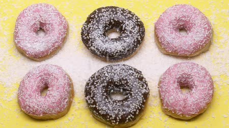 high calories : Donuts sprinkled with too much sugar, diabetes, junk food, unhealthy snacks Stock Footage