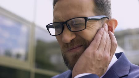 ear infection : Male eyeglasses has ear pain, bacterial infection, inflammation. Stock Footage