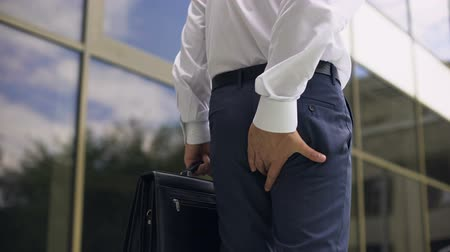 uncomfortable : Office worker feeling hemorrhoid pain while walking, sedentary lifestyle, health