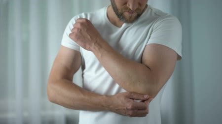 tense : Male suffering from elbow pain, chronic rheumatoid arthritis, joint inflammation