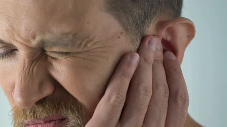 ear infection : Ageing male has ear ache after catching draft, bacterial infection, otitis pain