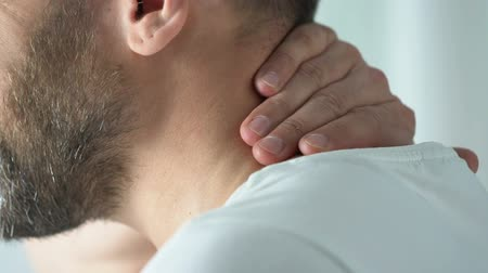 sudden : Senior male having neck ache during doctors visit, sharp sudden pain, therapy Stock Footage