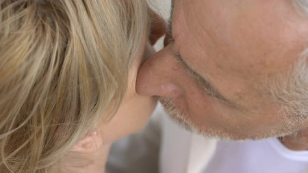 old times : Man in his 70s kissing his wife outdoors, tenderness and love, togetherness Stock Footage