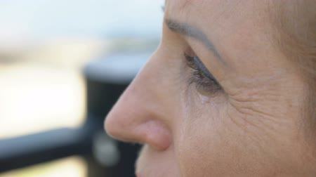 душа : Aged woman crying close-up, remembering departed native person, pain of loss