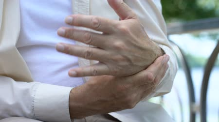 the inflammation : Senior man having pain in arm, problem with joint inflammatory arthritis Stock Footage