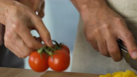 pepper : Couple preparing family dinner, slicing organic vegetables.