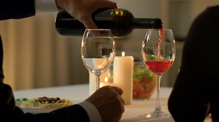 aperitief : Adult couple drinking old luxury wine in restaurant, degustation of beverage.