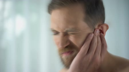 ear infection : Man feels pain in middle ear, meningitis and hearing loss, inflammation, closeup