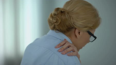 the inflammation : Female office worker suffering from shoulder pain, overworked, sedentary life