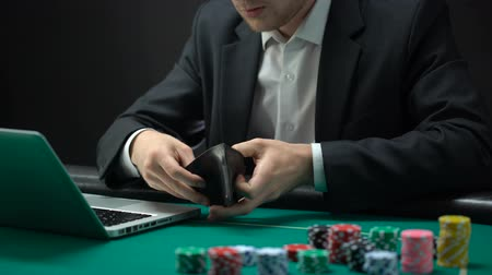 konkurzu : Nervous online gambler opening empty wallet, betting addiction, bankruptcy