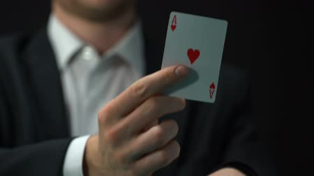 trik : Male player pulling ace from sleeve, business bluff strategy, chance to win