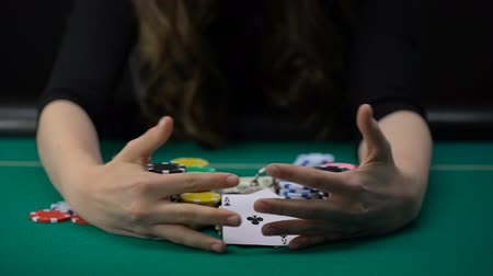 сочетание : Woman showing aces pair and taking all casino chips and money, game winner.