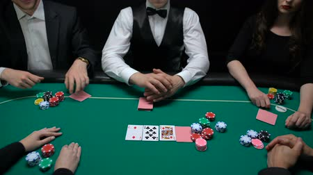 сочетание : Poker players betting and croupier opening card, upper class entertainment Стоковые видеозаписи