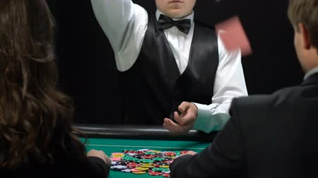 manipulacja : Croupier throwing cards on table wealthy people playing poker, gambling business Wideo