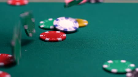 floş : Colourful chips falling on casino table, jackpot winning combination.