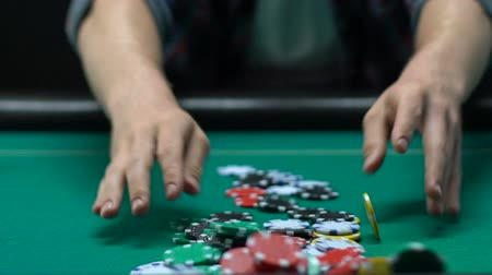 Ко : Risky man betting all chips in while playing poker in casino, gaming addiction Стоковые видеозаписи