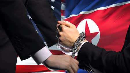 прикован : United States sanctions North Korea chained arms, political or economic conflict