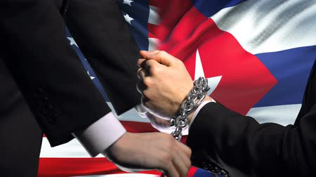 foreign national : United States sanctions Cuba, chained arms, political or economic conflict