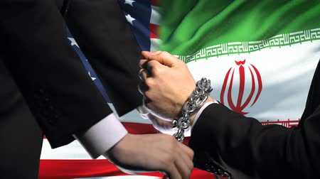 penas : United States sanctions Iran, chained arms, political or economic conflict