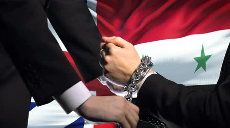 damasco : Great Britain sanctions Syria, chained arms, political or economic conflict
