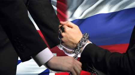 penas : Great Britain sanctions Russia, chained arms, political or economic conflict