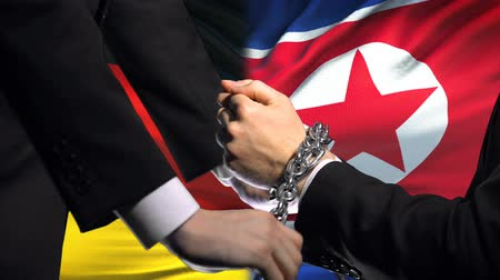 barriers : Germany sanctions North Korea, chained arms, political or economic conflict Stock Footage
