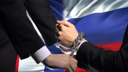 tilalom : France sanctions Russia, chained arms, political or economic conflict, trade ban Stock mozgókép
