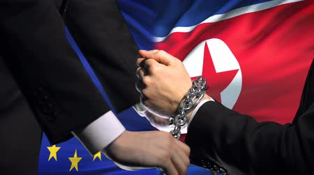 запретить : European Union sanctions North Korea chained arms political or economic conflict Стоковые видеозаписи