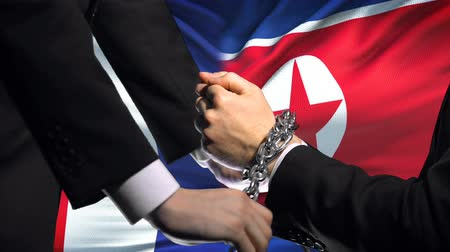 penas : France sanctions North Korea, chained arms, political or economic conflict Stock Footage