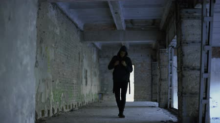 outsider : Lonely boy walking in abandoned building, afro-american has no friends. Stock Footage