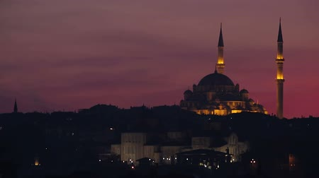 ottoman : Sultan Ahmed Mosque in Istanbul Turkey illuminated at night, red sky timelapse