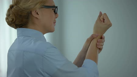 chronic : Business woman touching wrist, suffering rheumatoid arthritis, health care Stock Footage
