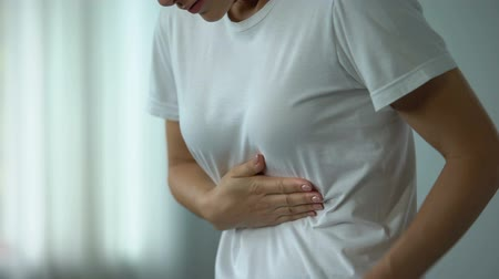 bol : Female feeling stomachache, suffering from peptic ulcer, unhealthy eating result