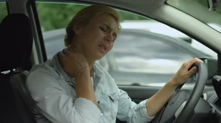 sedentary : Female driver feeling neck pain, back muscle inflammation, sedentary lifestyle