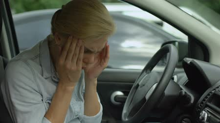 napětí : Blond female sitting in car and feeling strong headache, taking drugs, medicine Dostupné videozáznamy