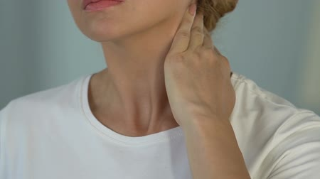 sérülés : Female suffering from neck pain, turning head to relieve ache, whiplash injury
