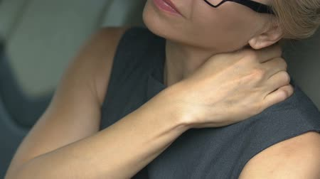 painéis : Woman tired after work day massaging neck, relaxation, distraction from problems