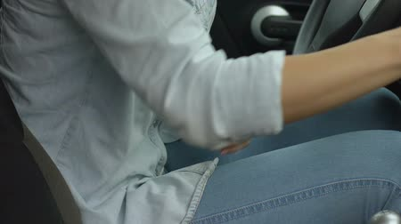 menstrual : Female in car suffers from menstrual pain, taking medications.