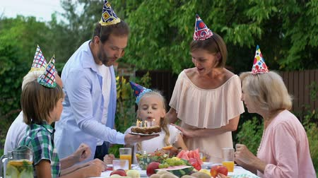 заботливый : Family congratulating little girl on birthday, celebrating, pleasure emotions