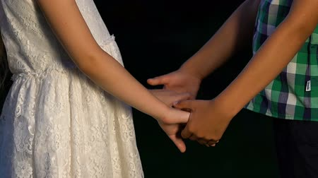 shy : Little boy taking girls hands and kissing her, cute moments, innocent friendship Stock Footage