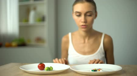 решить : Girl chooses vegetables instead of weight loss drugs, healthy diet, organic food