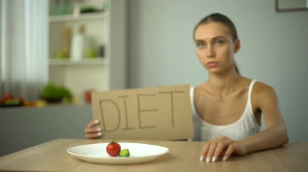 obsession : Diet word written by depressed anorexic girl, starving body, eating disorder Stock Footage