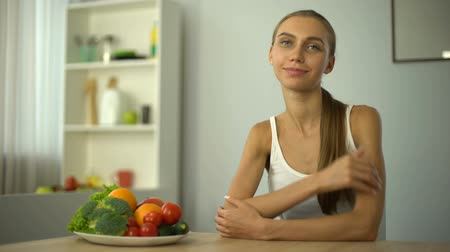 диета : Skinny girl showing thumbs up, recommending vegetables, health, proper nutrition Стоковые видеозаписи