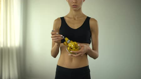 obsession : Fitness girl eating measuring tape, concept of bmi control, food restrictions Stock Footage